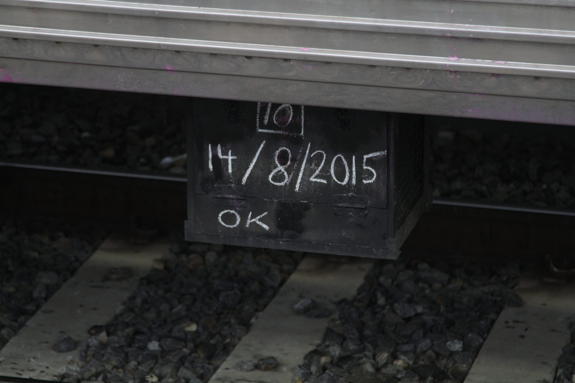 dated chalk markings on the underside of a comeng train wongm s