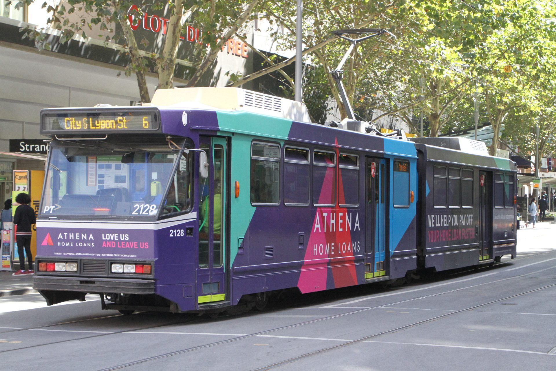B2 2128 advertising 'Athena Home Loans' heads north on route