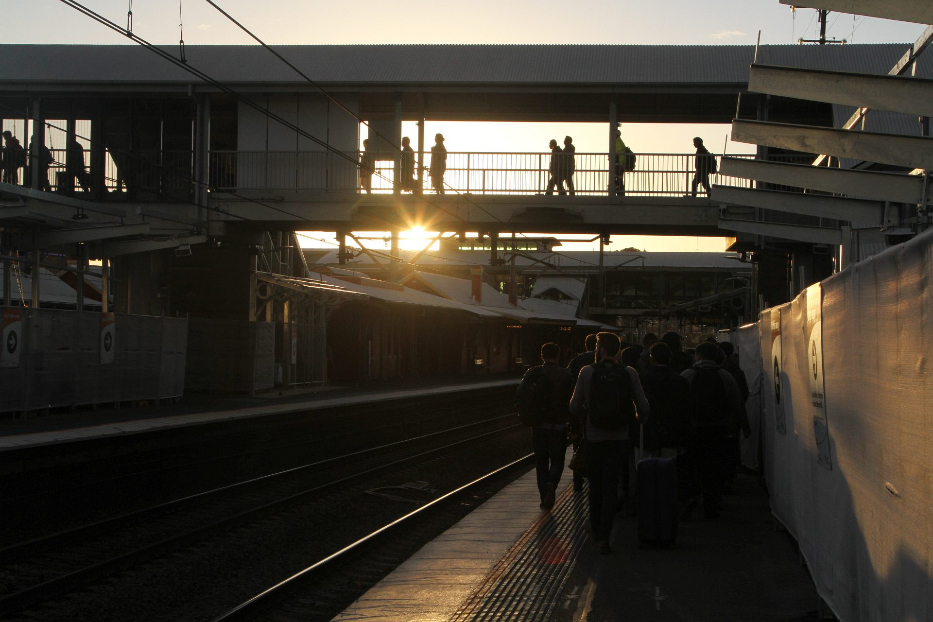 Evening commuters at Lidcombe station ...