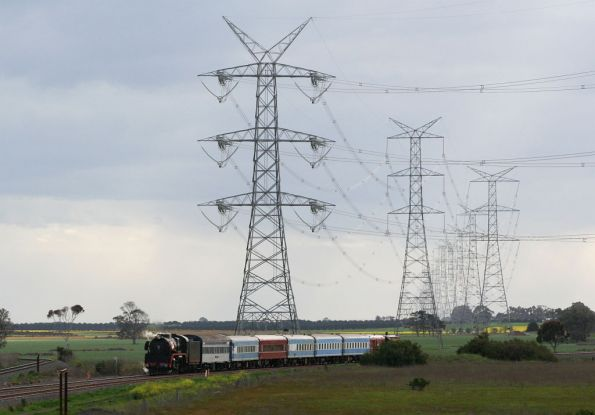 Transmission lines tower over the train at Gheringhap