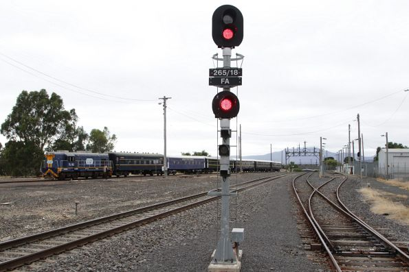 TL152 shunts the standard gauge train out of the siding at Ararat