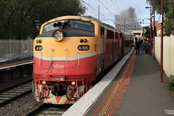 A66 leads the train into the platform art Newport, with the exhaust from R707 rising into the sky behind
