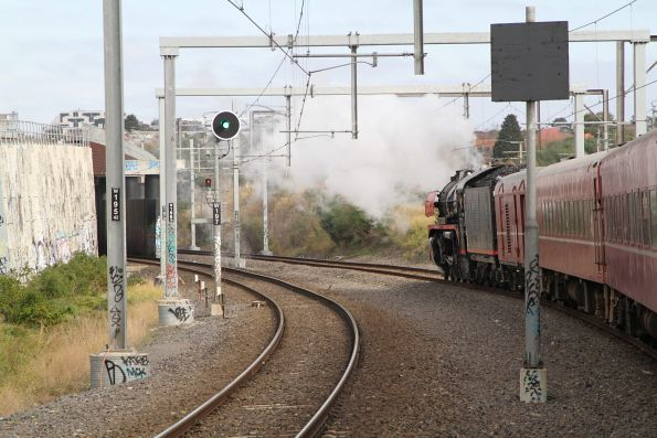 R707 trails the train under the RRL track at Footscray