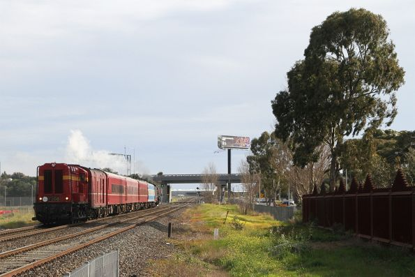 F208 trails the train under the Western Ring Road bound for Caroline Springs