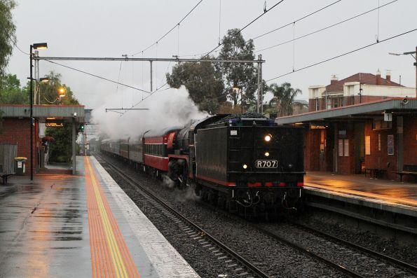 R707 tender first leading the up empty cars move through Seddon station