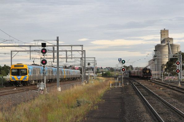 Citybound Comeng train passes R707 on the down at Sunshine