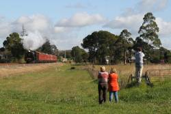 Plenty of onlookers line the trains as A2 986 leads the train out of Warragul