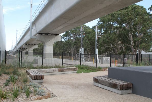 Landscaped area with seating beneath the Abbotts Road rail overbridge