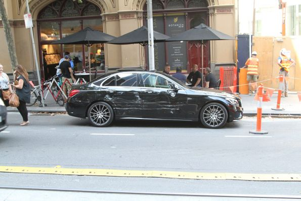 Smashed up BMW on Collins Street, thanks to an excursion into the tram lane
