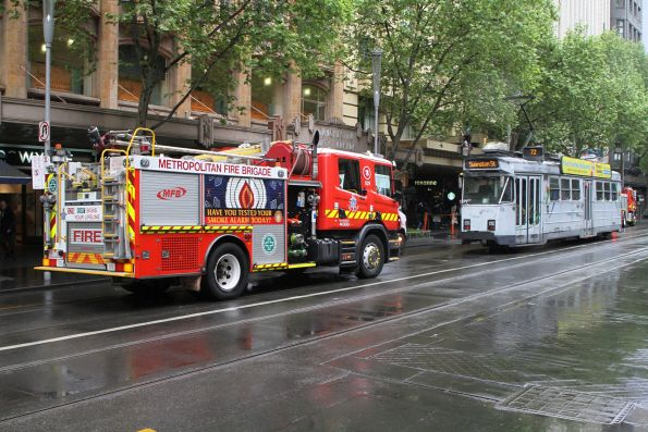 Fire truck delayed by tram Z3.133 on Swanston Street, which is in turn delayed by a fire truck parked over the tram tracks