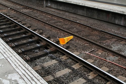 'Caution wet floor' sign on the tracks at Flinders Street Station