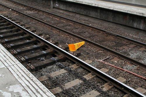 'Caution wet floor' sign on the tracks at Flinders Street Station