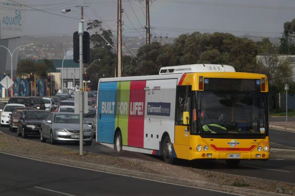 Bus #1235 on a route 241 service along Morphett Road, waits for a train at Oaklands Park