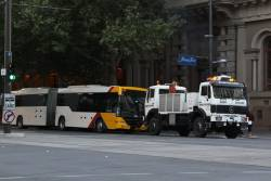 Busway recovery truck on the move with a disabled bus on King William Street