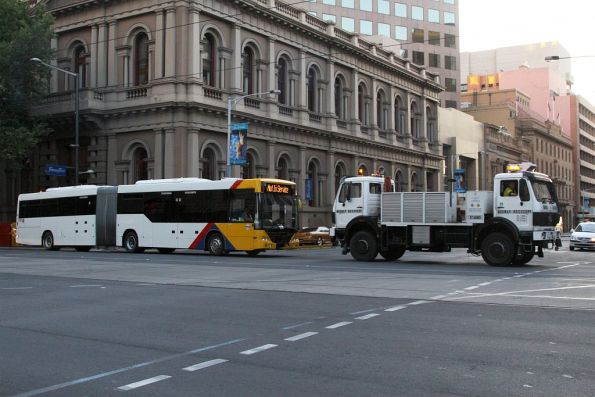 Disabled artic #1147 under tow at Currie and King William Streets