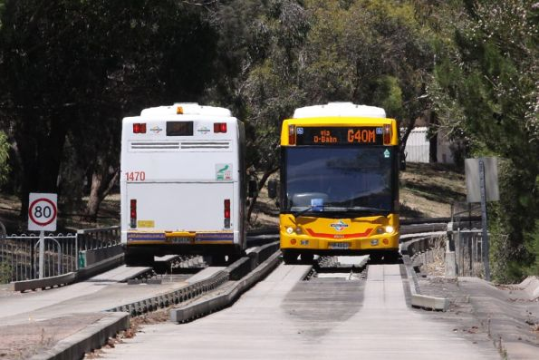 Buses pass each other at the end of the busway at Tea Tree Plaza
