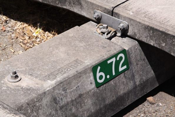 'O-Bahn' cast into the concrete crossheads, the green sign marks the 6.72 km mark on the guideway