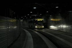 Passing a citybound route M44 bus inside the O-Bahn tunnel