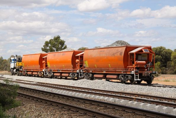 Coleman Rail hi-rail pushing loaded ballast wagons at Parafield Gardens