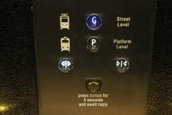 Tram and train icons in the Adelaide station lift
