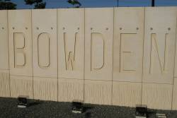 'BOWDEN' cast into the concrete retaining wall at the new grade separated station