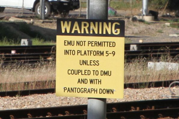 'EMU not permitted into platforms 5-9 unless coupled to EMU and with pantograph down' sign on signal 104 at Adelaide station