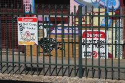 'DANGER do not cross the track' sign replicated in mural form at Woodville station