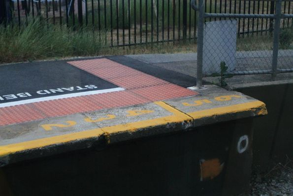 2, 3, 4,5 and 6 car stopping mark at the up end of the platform at Mile End