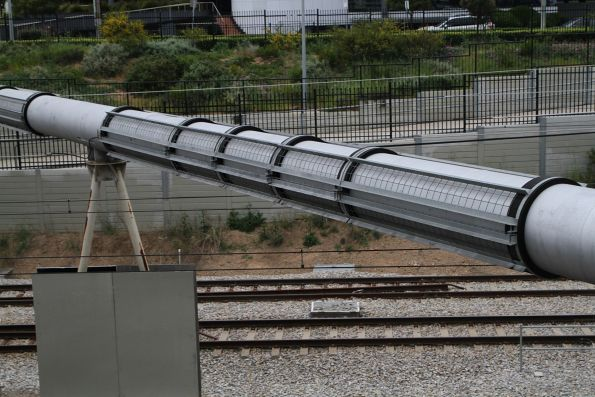Insulated steel mesh protects the steel pipe where it crosses the 25 kV AC electrified railway at Keswick