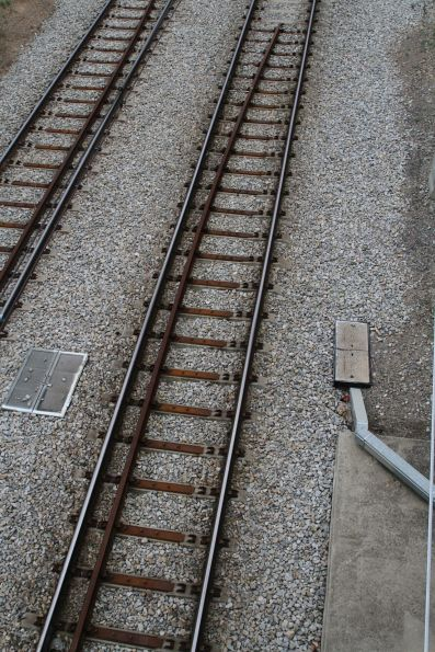 Guard rails affixed to concrete sleepered track at Keswick Bridge