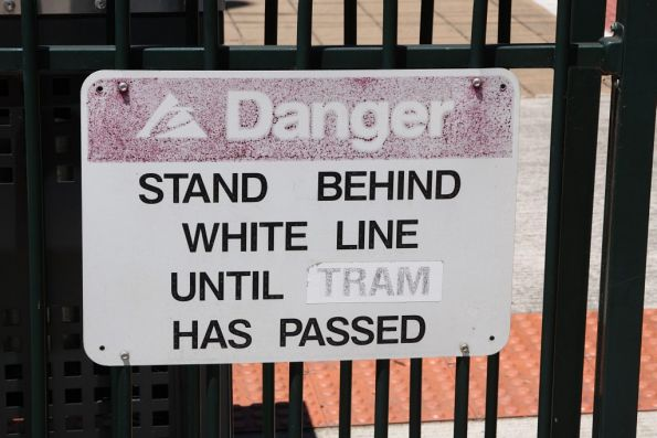 TransAdelaide signage at a tram stop, with