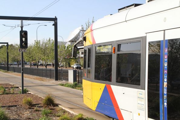 White 'T' light for Flexity #110 departing the Entertainment Centre terminus