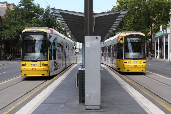 Flexities 105 and 104 pass each other at the Adelaide Railway Station stop
