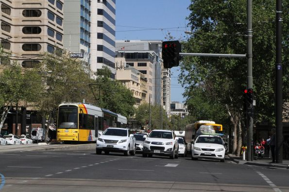 Flexity #110 headed for the Botanic Gardens at North Terrace and King William Street