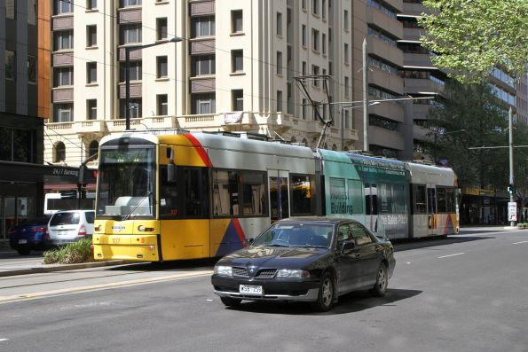 Flexity #107 heads north at King William Street and Rundle Mall