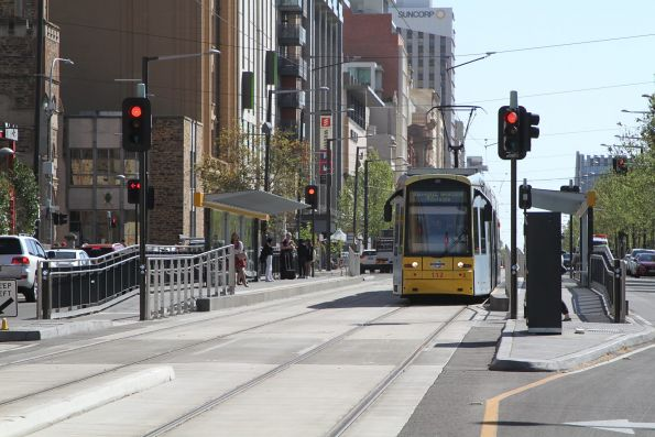 Flexity #112 heads east along North Terrace at University
