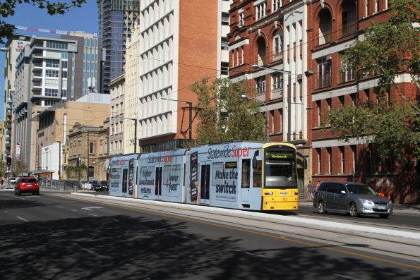 Flexity #112 heads west along North Terrace at Art Gallery