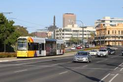 Flexity #110 heads north on Port Road at the Adelaide Gaol