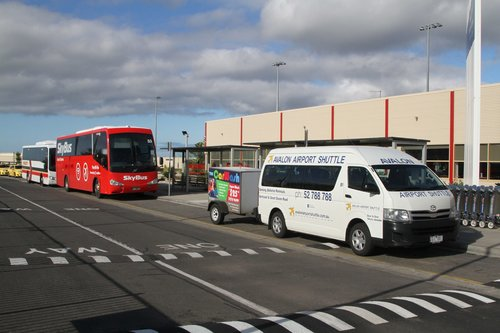 Avalon Airport Shuttle minivan #B1 ZDI887 and SkyBus coach #53 BS01JF at Avalon Airport