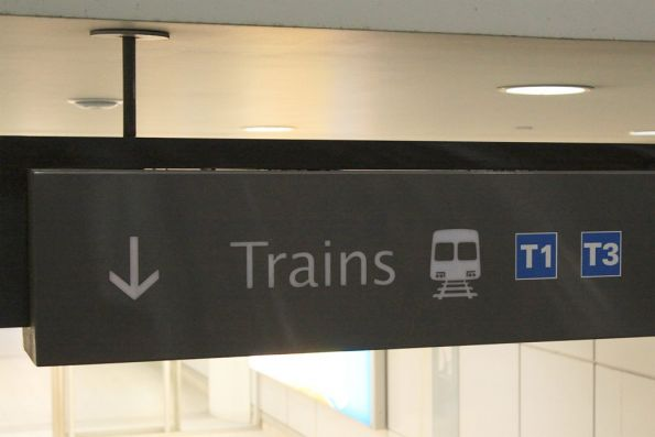 Melbourne-style train icon on signage at Sydney Airport terminal 2