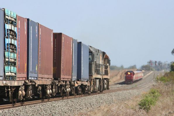 SG freight passing a push pull set