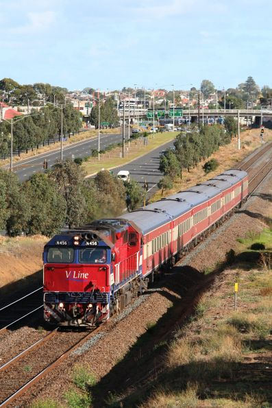 N456 leads a 7 car long up pass at North Geelong