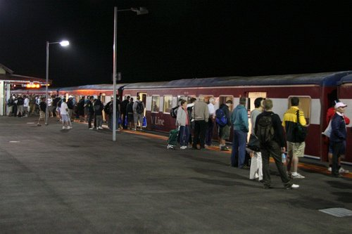 Crowd of homeward bound airshow patrons wait to board the train at Lara