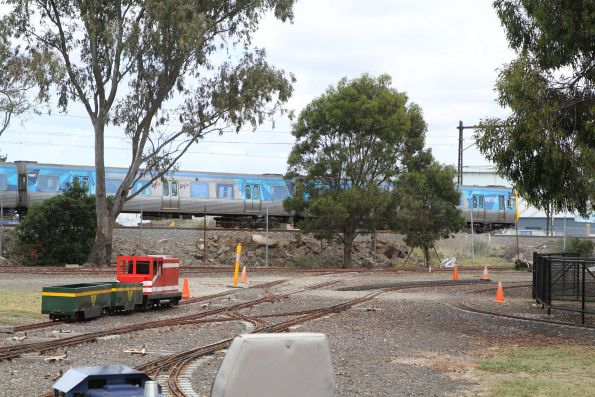Werribee line train passes the Altona Miniature Railway