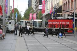Tilt tray truck does a three point turn in the Bourke Street Mall, delaying trams