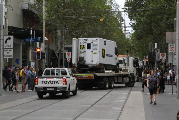 Tilt tray truck exits the Bourke Street Mall