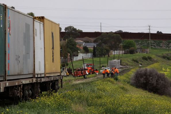 The freight has passed, and the workers get back into it