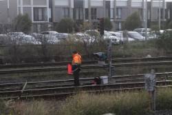 Flagman protecting a work site on the dual gauge goods lines at West Footscray