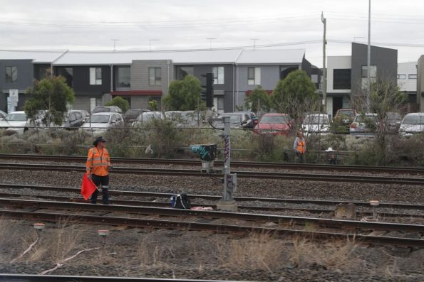 Flagmen protect the broad and standard gauge tracks at West Footscray