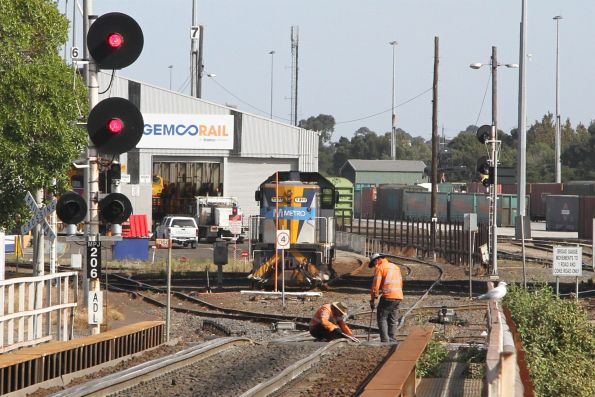 Trackworkers maintain the points at the western end of South Dynon
